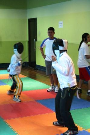 Coach Wawit Torres will be doing a fencing demo