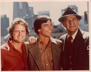 Richard Hatch (middle) eventually replaced Douglas in the last season of the show.